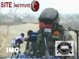 site-institute---11-29-05---the-victorious-army-group-issues-a-video-depicting-the-falling-of-rockets-on-an-american-base-in-tikrit