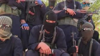 Kazakh Fighter Calls for Participation in Syrian Jihad in ISIL Video