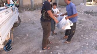 Himam News Video Shows al-Nusra Front Distributing Food Aid in Homs