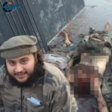 Austrian Jihadist-IS Fighter Mohamed Mahmoud Photographed with Beheaded Bodies