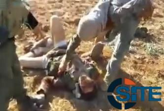 Video Purports to Show Ahrar al-Sham Fighters Beating IS Fighter Prior to Beheading Him