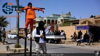 "IS Crucifies, Executes Two Spies for ""Crusader Coalition"" in Public in ar-Raqqah"