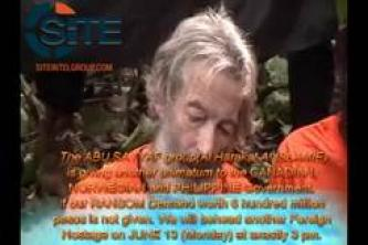 Abu Sayyaf Group Threatens in New Video to Execute Foreign Hostage if Demand not Met by June 13
