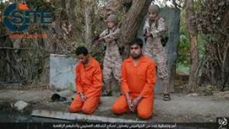 IS Photos Show Children Executing Accused Spies in Northern Iraq