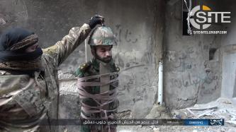 IS Shows Execution of Syrian Soldier Using Unusual Method in Damascus