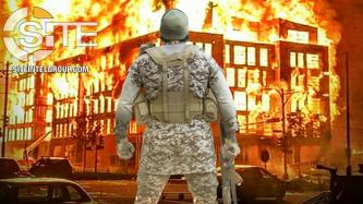Pro-IS Group Depicts Fighter in Front of Burning Minneapolis Police Station to Highlight IS Spokesman's Words