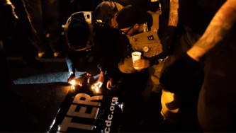 Proud Boys Leader Claims Responsibility for BLM Banner Burning at D.C Trump Rally