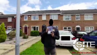 Members of British Far-Right Political Party Distribute Propaganda for Recruitment